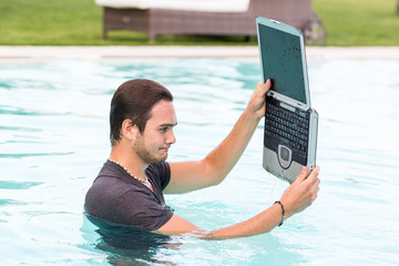 Ma with Computer in the Swimming Pool