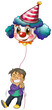 A happy boy holding a clown balloon