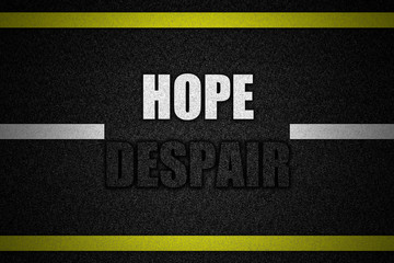 Traffic  road surface with text HOPE DESPAIR