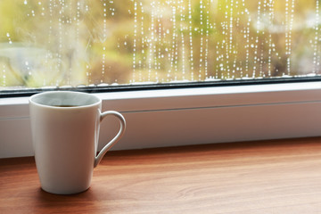 cup of hot coffee on the windowsill