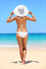 Woman on beach travel vacation lifestyle concept