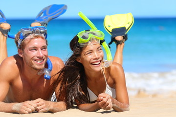 Beach travel couple having fun snorkeling