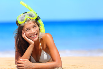 Woman on beach vacation holidays with snorkel