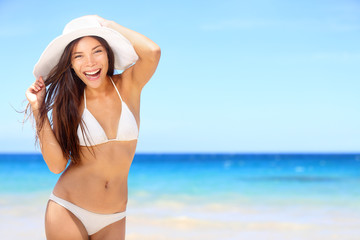 Beach woman happy on travel vacation in bikini