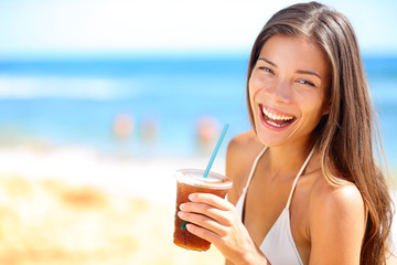 Beach woman drinking cold drink beverage