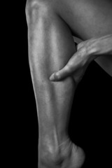 Pain in the female calf muscle