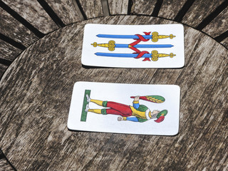 Two cards on a wooden table