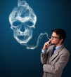 Young man smoking dangerous cigarette with toxic skull smoke