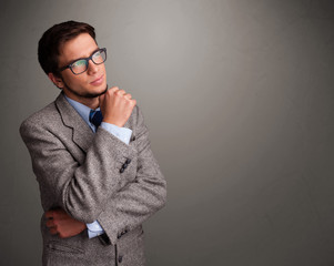 Young man thinking with empty copy space