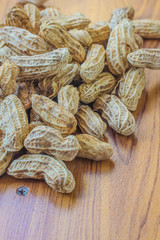 Peanuts on the ground in my kitchen room.