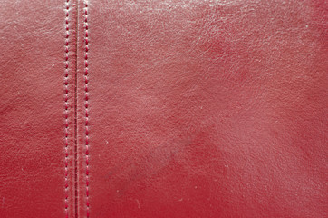 Sewing red leather texture background