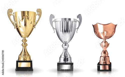 Leinwandbild Motiv three different kind of trophies. Isolated on white background
