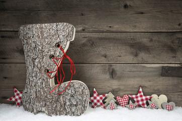 Rustikaler weihnachtlicher Holz Hintergrund mit Nikolausstiefel