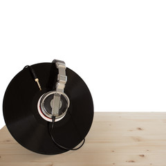 vinyl with headphones on wooden table, square format
