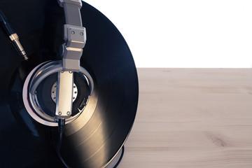 Dj headphones with vinyl on wooden table