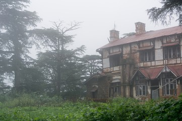 Old house in fog