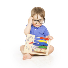 Boy child with abacus clock in glasses counting, smart kid