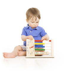Boy child with abacus clock counting, little kid education