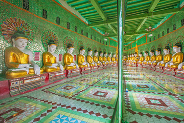 Buddhas and wall in temple, Sagaing hill, Mandalay, Myanmar