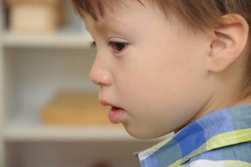 Boy looking sad closeup