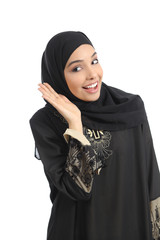 Arab saudi emirates woman gesturing listening with a hand on ear