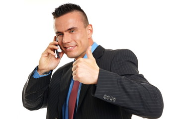 Young man in suit talks into mobile phone