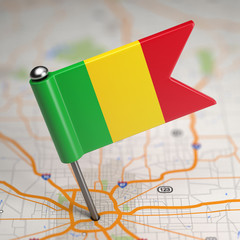 Mali Small Flag on a Map Background.