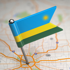Rwanda Small Flag on a Map Background.