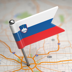 Slovenia Small Flag on a Map Background.