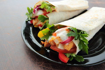 Tasty tortilla wraps with chicken and fresh vegetables