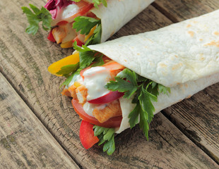 Tortilla wraps with chicken, garlic sauce and fresh vegetables