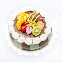 Chocolate fruit cake isolated on white  The model of dollhouse