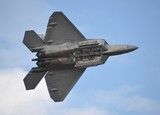 F-22 Raptor with Weapons Bay Deployed poster
