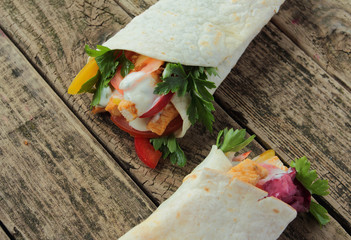 Fresh tortilla wraps with chicken and fresh vegetables