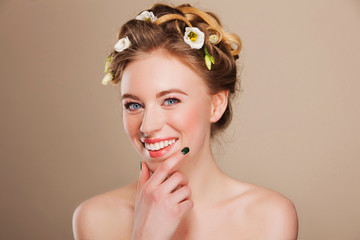 young happy woman with flowers  in her hair