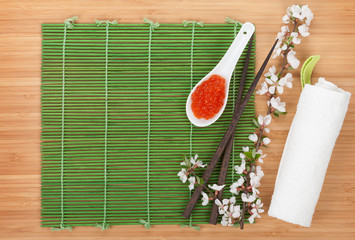 Red caviar, sakura branch and chopsticks