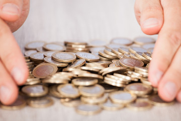 Businessman's Hands Collecting Euro Coins
