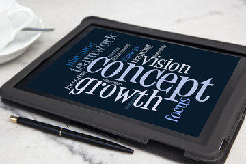 tablet with growth concept word cloud