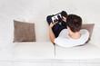 Man Watching Movie On Digital Tablet In Living Room