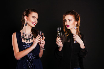 Couple of women celebrating and toasting birthday.