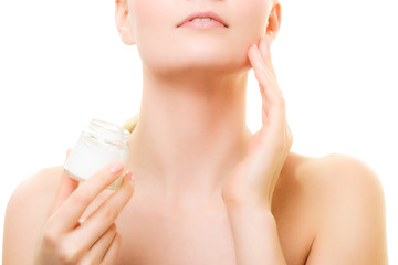 Skin care. Girl applying moisturizing cream