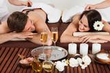 Fototapety Couple Enjoying Hot Stone Massage At Spa