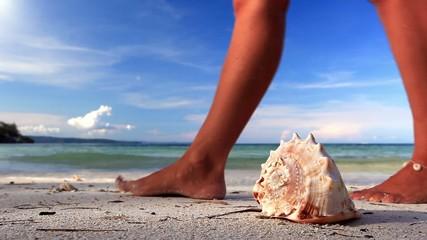 Seashell and woman on tropical beach, Boracay, Philipp