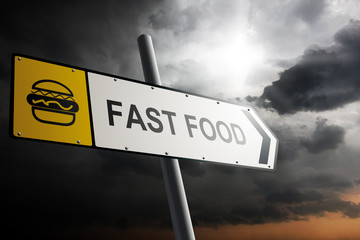 Fast food direction. Yellow traffic sign.