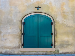 Teal Door on Stone Wall
