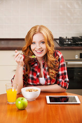 woman using a tablet in the kitchen