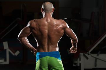 Mature Muscular Man Flexing Muscles