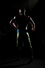Siluet Muscular Man Flexing Muscles