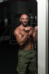 Mature Man Working Out In A Health Club