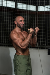 Mature Bodybuilder Exercising Biceps